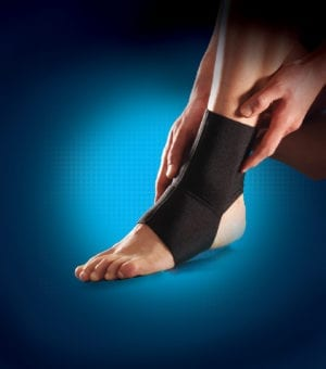 A person wearing a Thuasne Neoprene ankle support