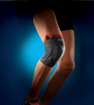 A person's knee wearing a Thuasne Reinforced Knee Support