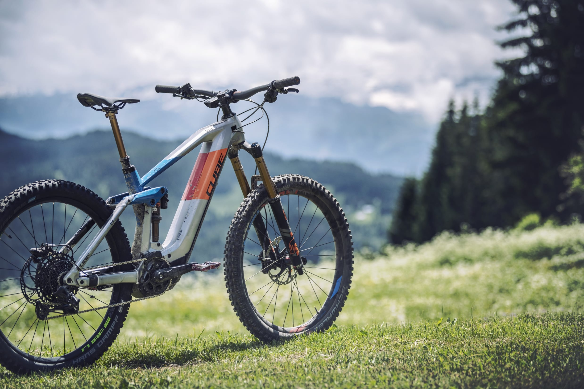 Cube Stereo Hybrid 160 HPC SL 2020 bike with a wooded background